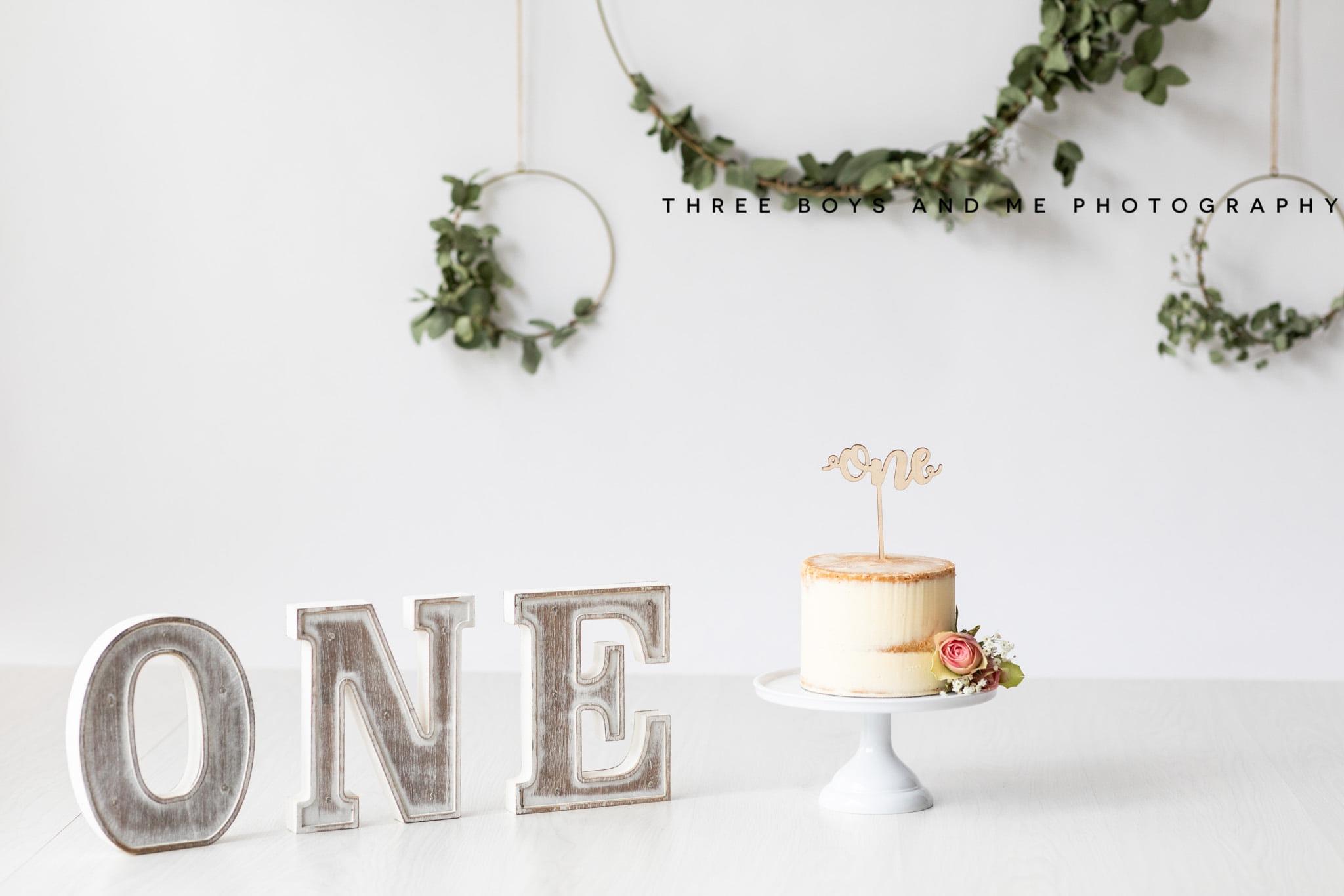 Neutral cake smash set up including nude cake with single rose decoration at a cakesmash photoshoot in Bexley
