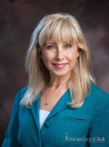 Blond haired business woman wearing blue jacket business attire