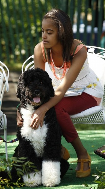 Malia Obama holds her dog Bo at the Easter Egg Roll, at the White House in Washington