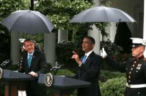 Marines hold umbrellas over U.S. President Barack Obama