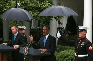 Marines hold umbrellas over U.S. President Barack Obama1