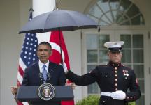 Marines hold umbrellas over U.S. President Barack Obama11