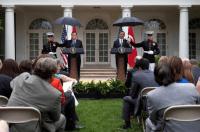 Marines hold umbrellas over U.S. President Barack Obama12