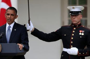 Marines hold umbrellas over U.S. President Barack Obama5