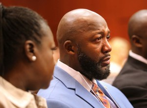 Tracy Martin cries as he listens to the description of his son's death as Sybrina Fulton looks on during the opening day of the George Zimmerman trial in Seminole circuit court in Sanford