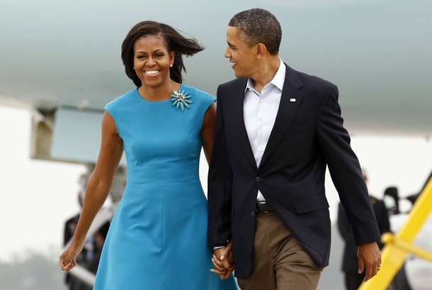 U.S. President Barack Obama and first lady Michelle Obama walk from Air Force One upon their arrival in Columbus