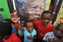 Children react during a gathering of mourners on Vilakazi Street in Soweto