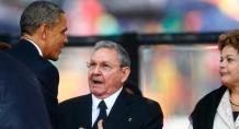 U.S. President Obama greets Cuban President Castro at the memorial service for Mandela in Johannesburg