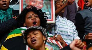 People sing and dance ahead of Mandela's national memorial service in Johannesburg