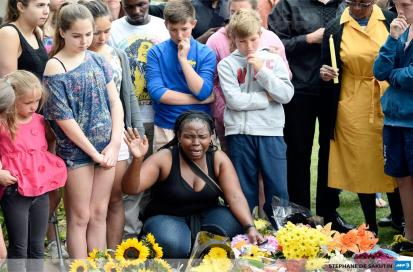 South Africans grieve outside Nelson Mandela's home in Johannesburg