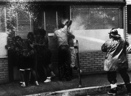 "Violent techniques used on peaceful protesters in 1963. During desegregation protests in 1963, city officials, at the order of the brutally violent police commissioner Eugene ""Bull"" Conner, used fire hoses and clubs on un-armed, nonviolent protesters. Pictures like this one raised global awareness for the civil rights movement. Source: © AP Photo."
