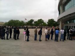 ACA Surge-Folks are lined up at the Alamodome in San Antonio.