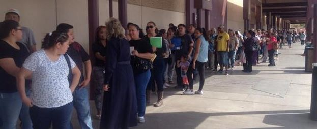 ACA Surge13-Hundreds waited outside at a shopping center in Las Vegas this weekend to sign up for health coverage under the Obama health law