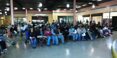 ACA Surge16-Several hundred people waited at the Gateway Mall in Jacksonville, Florida on Sunday to sign up for the Obama health law.