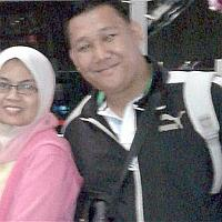 Faces of MH370- Couple on vacation.