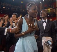 Lupita looked completely overcome with emotion as she got up from her seat