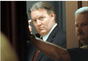 Michael Dunn looks back into jury room