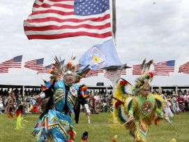 Barack- Native American dancers from more than 20 reservations in North and South Dakota perform before the arrival of President Barack Obama and first lady Michelle Obama on the Standing Rock Indian Reservation