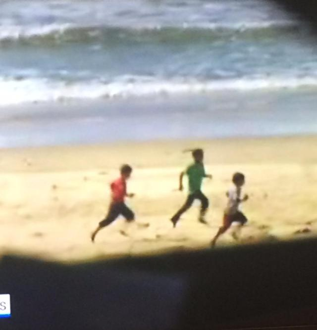 Palestinian boys running from the bombs