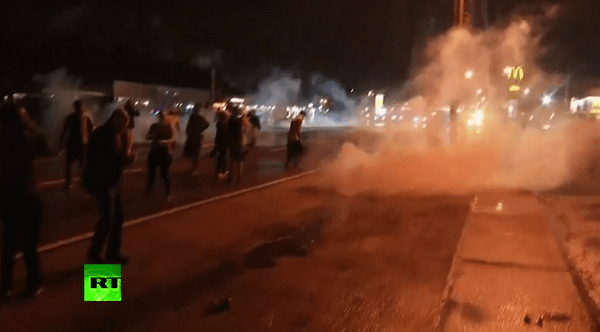 Ferguson police fire tear gas at protesters