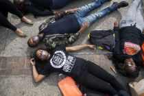 UTSA senior Ashely Andrews & junior Chad Davis lay during a Die-in in honor of MichaelBrown and EricGarner.