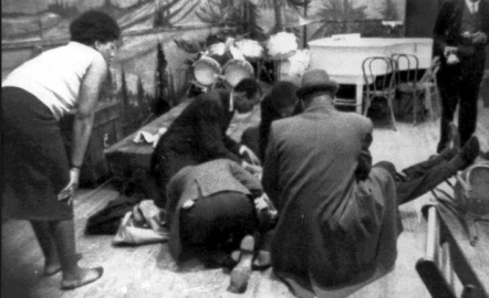Mortally Wounded. Followers tend to Malcolm X as he lies mortally wounded on the stage of the Audubon Ballroom in New York City, February 21, 1965.Malcom X was shot 15 times at point blank range.Credit: WCBS-TV/AP