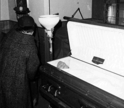 Malcolm X's Funeral. Malcolm X's widow, Betty Shabazz, takes a last look at the body of her husband before the casket is closed after funeral services at the Faith Temple of God in Christ in New York's Harlem, February 27, 1965. Loudspeakers carried the service to the overflow crowd outside the 1,000-seat church. Credit: AP