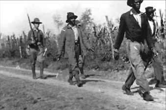 African American men, pictured here, were taken prisoner for the Elaine Race Massacre in Arkansas in 1919. It's estimated that hundreds of African Americans were killed during the mob violence that erupted. FIve white men were killed.
