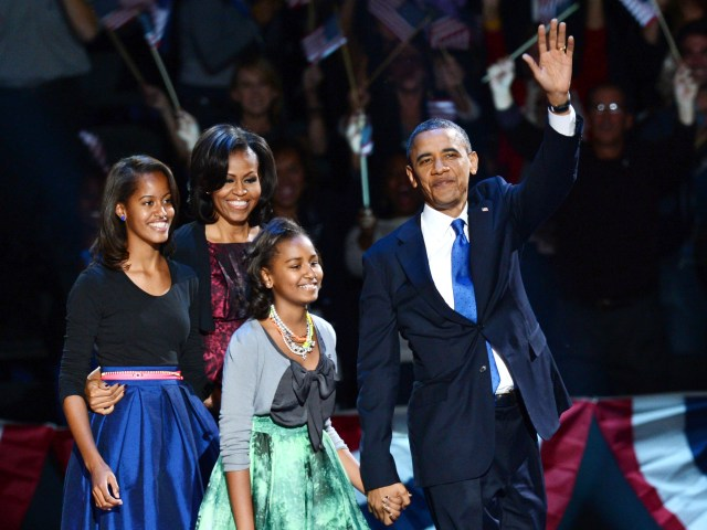 US President Barack Obama and family arrive on stage after winning the 2012 US presidential election November 7, 2012 in Chicago, Illinois.  Obama swept to re-election, forging history again by defying the dragging economic recovery and high unemployment which haunted his first term to beat Republican Mitt Romney.   AFP PHOTO / Saul LOEBSAUL LOEB/AFP/Getty Images