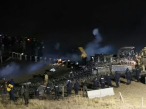 Tara Houska, an organizer with Honor the Earth, told the Bismarck Tribune that the Cannon Ball gym was opened to aid people who had been doused with water or tear gas Read more: http://www.dailymail.co.uk/news/article-3955878/Police-protesters-face-Dakota-Access-pipeline.html#ixzz4QdNVE67c Follow us: @MailOnline on Twitter | DailyMail on Facebook