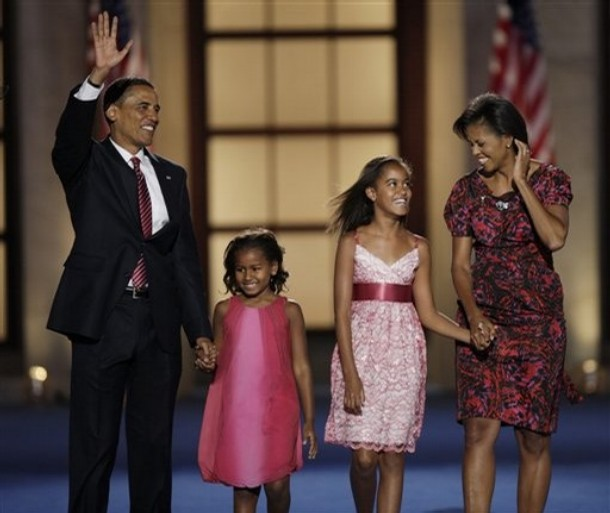 Democratic presidential nominee, Sen. Barack Obama, D-Ill., his wife, Michelle, and daughters Malia, 10, second from right, and Sasha, 7, wave after his acceptance speechat the Democratic National Convention in Denver, Thursday, Aug. 28, 2008.  (AP Photo/Ron Edmonds)