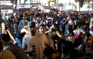 People flee the Route 91 Harvest country music festival grounds after a active shooter was reported on October 1, 2017 in Las Vegas, Nevada. CREDIT: Getty