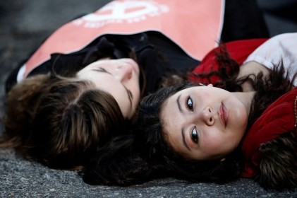 Students from Fiorello H. Laguardia High School lie down on West 62nd street in support of the National School Walkout in the Manhattan borough of New York City, New York, U.S., March 14, 2018. REUTERS/Mike Segar - RC1F52991260