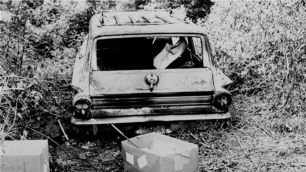 """June 24, 1964, photo shows the burned station wagon of Michael Schwerner, Andrew Goodman and James Chaney in a swampy area near Philadelphia, Miss. The bodies of the men were found later in an earthen dam. Their deaths inspired the 1988 movie """"Mississippi Burning"""""""