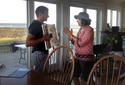 Annie giving Paul an accordion lesson