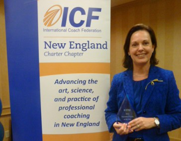 Angie O'Donnell receives the 2013 New England Executive Coach of the Year award from the International Coach Federation.