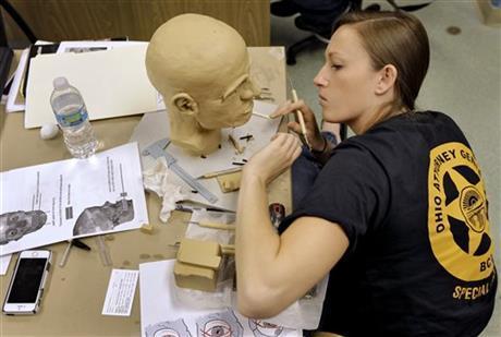Student Samantha A.J. Molnar at work on a facial reconstruction. (AP Photo/Chris O'Meara)