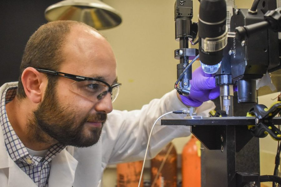 Arda Gozen, assistant professor, WSU School of Mechanical and Materials Engineering, in the Manufacturing Processes and Machinery Lab. Photo via WSU News
