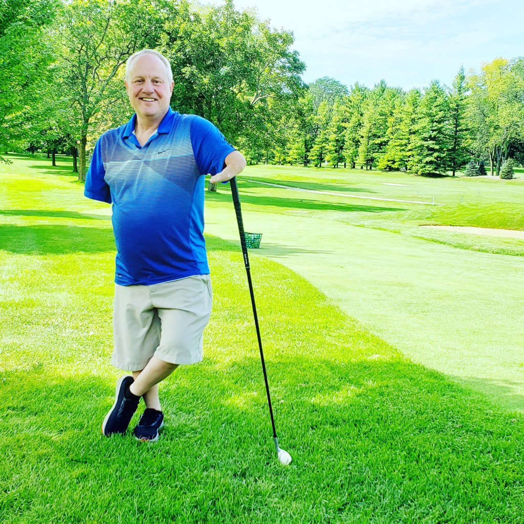 Chris Jackson, president of Terrafilum, on the golf course with his 3D printed golf club adaptor.