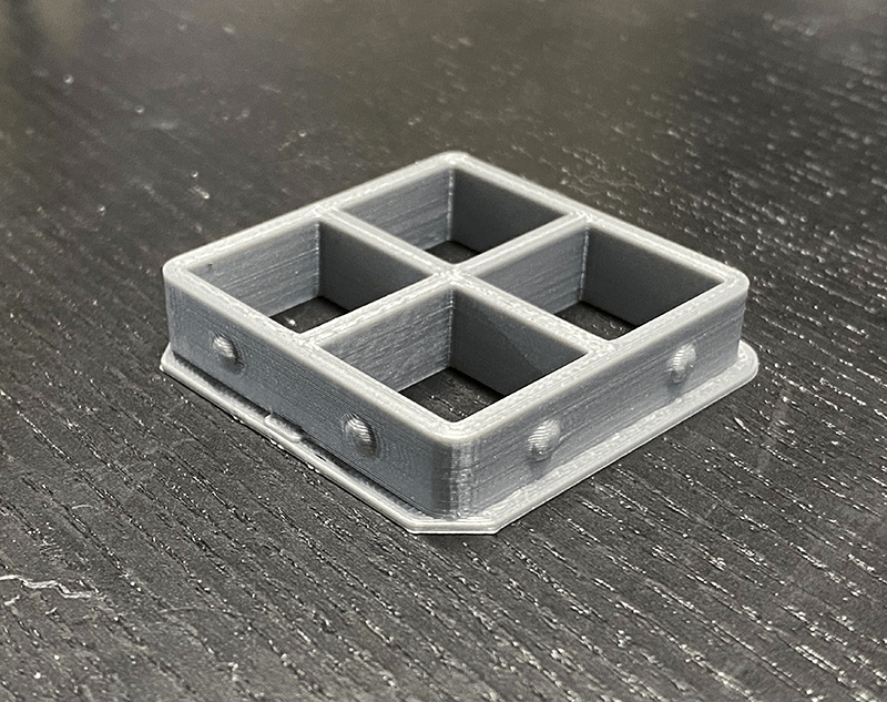 The 3D Printed BECMv1 - (Buffalo e-NABLE Crisis Mask) filter insert piece showing the design