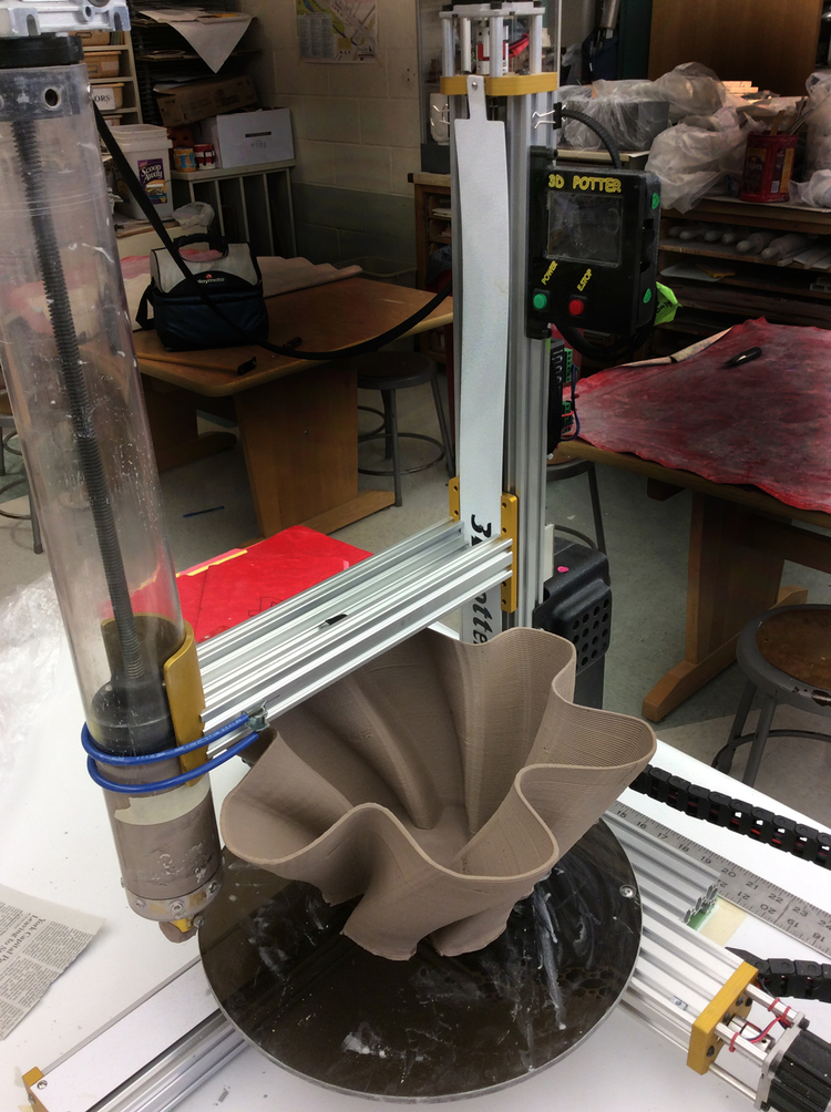 A view of the 3D Potter 3D printer in action, creating a ceramic bowl
