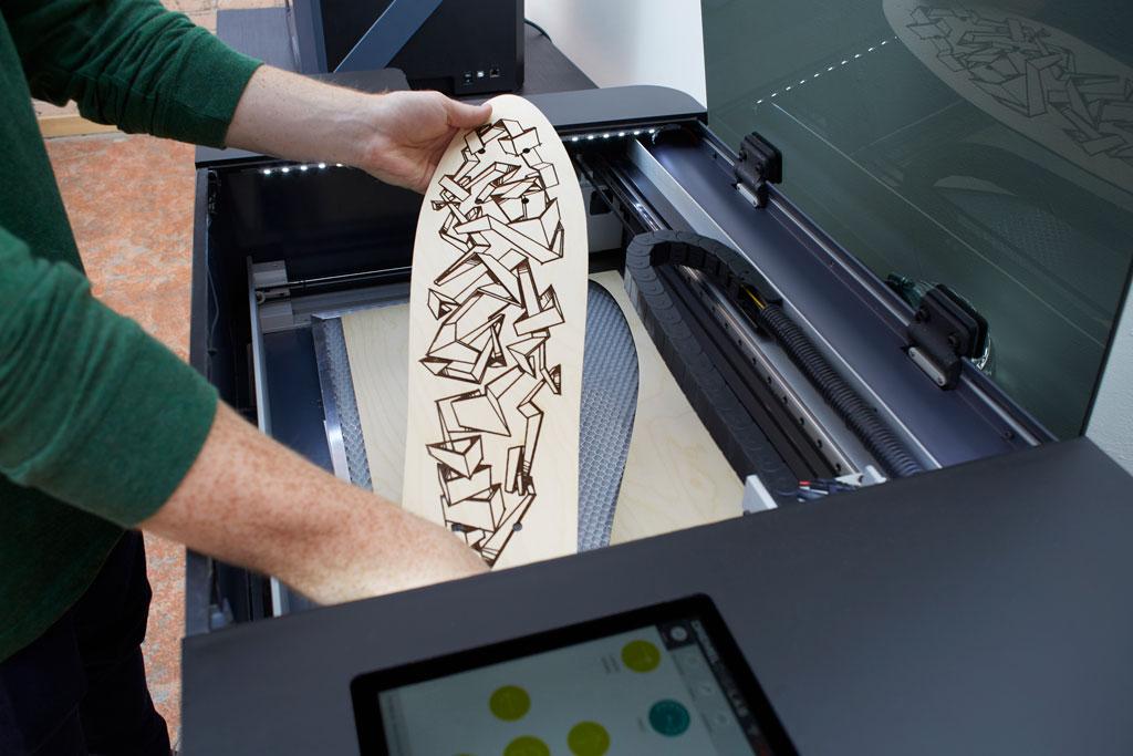 Dremel DigiLab LC40 Laser Cutter creating a skateboard deck