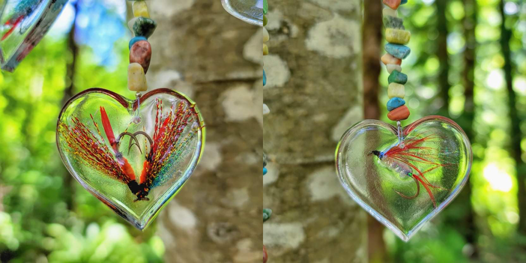 Fishing flies encased in resin in a heart shape for a memorial mobile.