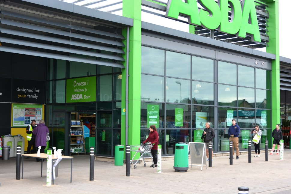 ASDA STORES, CUSTOMERS QUEUE TO ENTER THE STORE DURING CORONAVIRUS PANDEMIC