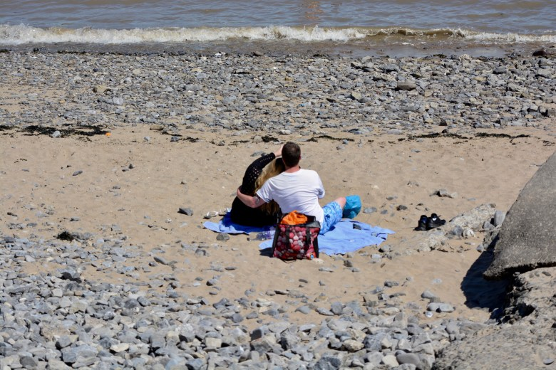 Easing of lockdown rules for covid-19 Barry. Couple on beach