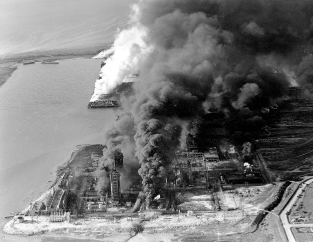 Refineries and oil storage tanks of the Monsanto chemical plant burn in the waterfront area in Texas City, Texas, on April 16, 1947. The disaster, caused by the explosion of the nitrate-laden French ship Grandcamp, caused 561 deaths. (AP Photo)