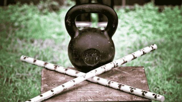 Kettlebell and two sticks   Why The Kettlebell Is The Ultimate Tool For Physical Preparedness