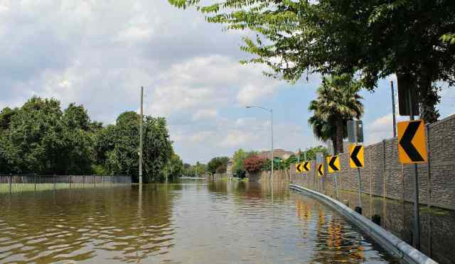 Flooded road   Flood Survival Tips   How To Survive Before, During, And After A Flood