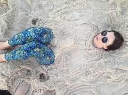 StephC buried in sand with Tinkergogh Leggings