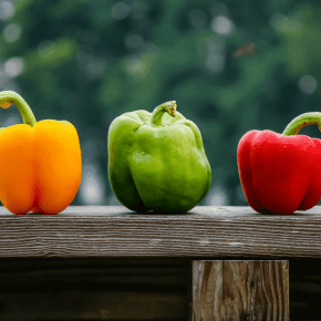 bell peppers on a board